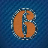 Number 6 made from leather on jeans background Stock Photo