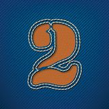Number 2 made from leather on jeans background Stock Photos