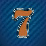 Number 7 made from leather on jeans background Royalty Free Stock Image