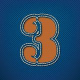 Number 3 made from leather on jeans background Royalty Free Stock Photo