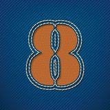 Number 8 made from leather on jeans background Royalty Free Stock Photography