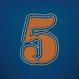 Number 5 made from leather on jeans background Stock Photos