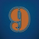 Number 9 made from leather on jeans background Royalty Free Stock Photo