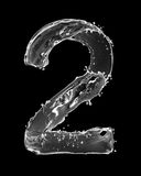 Number 2 made with a splashes of water isolated on black Stock Photography