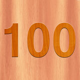 Number 100 made with wood in wood Background. Number 100 made with wood Stock Images
