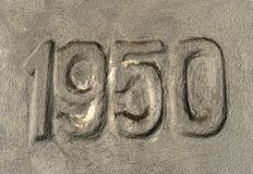 Number 1950 marked in the concrete. Wall stock image