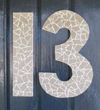 Number 13. Maybe unlucky but this  mounted on a house wall Stock Photo