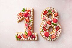 Number 18 naked honey cake for Birthday, pink background