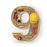 Number 9 nine. Alphabet from the tools on the metal pegboard iso Stock Photos