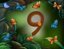 Number nine with 9 butterflies in the garden Stock Photos
