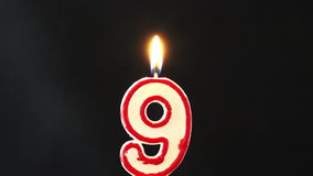 Number nine candle burning 4K stock video footage
