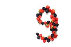 Number nine with fruits. Number nine made from strawberry, raspberry and blackberry fresh fruits Royalty Free Stock Images