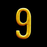 Number nine golden arabic  isolated on black background. Stock Photo