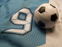 Number nine and soccer ball. Small soccer ball on the nuber nine uniform Royalty Free Stock Photos