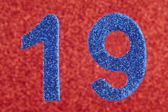 Number nineteen blue color over a red background. Anniversary. Stock Photography