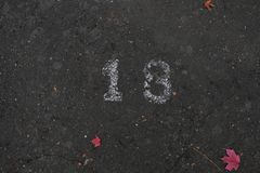 Number nineteen 18 on the street in white paint royalty free stock image