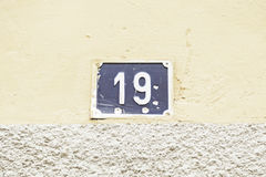 Number nineteen in a wall Stock Photography