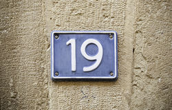 Number nineteen in the wall. Exploration in the city Stock Photography