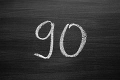 Number ninety enumeration written with a chalk on the blackboard Royalty Free Stock Images