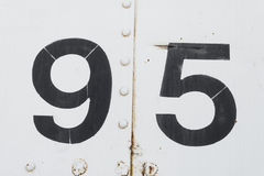 Number 95 ninety five white old metal background texture. Number 95 ninety five white background texture from an old metal train car. nine and five Stock Photos