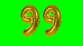 Number 99 ninety nine years birthday anniversary golden balloon floating on green screen -. Number 99 ninety nine years birthday anniversary golden balloon stock footage