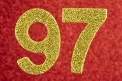 Number ninety-seven golden color over a red background. Annivers. Ary. Horizontal Stock Illustration