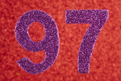 Number ninety-seven purple color over a red background. Annivers Stock Image