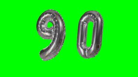 Number 90 ninety years birthday anniversary silver balloon floating on green screen -. Number 90 ninety years birthday anniversary silver balloon floating on stock video footage