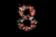 Number 8. Number alphabet made of real fireworks. Royalty Free Stock Images