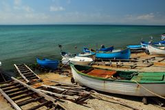 Number of old boats moored standing on logs on the shore, Pomorie, Bulgaria July 28, 2014 Royalty Free Stock Photography