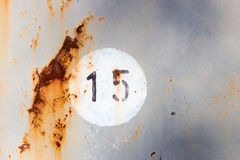 Number 15 on old metal panel Stock Photo