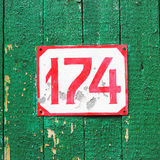 Number 174. On old painted wood Stock Photography
