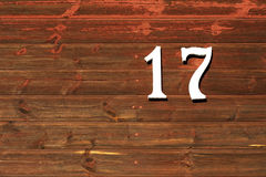 Number 17. Old red wall with number 17 in white Stock Photography