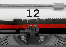 12 Number by the old typewriter on white paper stock photos