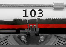 103 Number by the old typewriter on white paper. 103 Number text written by an old typewriter on white sheet stock photography