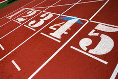 Number one. A number one on a red track field Royalty Free Stock Photography