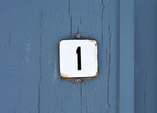 Number One. House Number One sign on blue painted wooden door Royalty Free Stock Photos