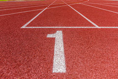 Number one on athletics running track Royalty Free Stock Photos