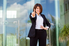 We are number one. Beautiful Hispanic businesswoman pointing out that her company is number one with her finger Stock Photography