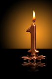 Number one candle. A photo of golden number one birthday candle Royalty Free Stock Image