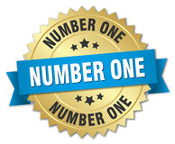 Number one 3d gold badge. With blue ribbon Royalty Free Stock Images