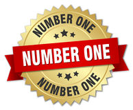 Number one 3d gold badge. With red ribbon Royalty Free Stock Photo