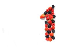 Number one with fruits. Number one made from strawberry, raspberry and blackberry fresh fruits Stock Photos
