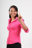 Number one gesture from beautiful woman in pink Royalty Free Stock Image