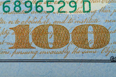 Number one hundred on a banknote 100 dollars. Number 100 in the lower right corner of the banknote one hundred dollars Royalty Free Stock Images