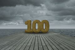 Number one hundred. On wooden floor at ocean Stock Photos