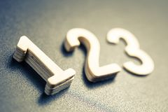 Number One Ranking. Wooden numbers for ranking concept, closeup at number one with shallow depth of field stock images