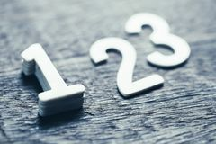 Number One Ranking. Wooden numbers for ranking concept, closeup at number one with shallow depth of field Stock Image