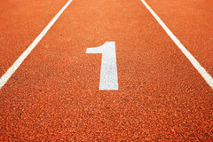 Number one on running track Stock Photography