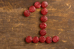 The number one shaped by raspberry hard candy on Royalty Free Stock Photos